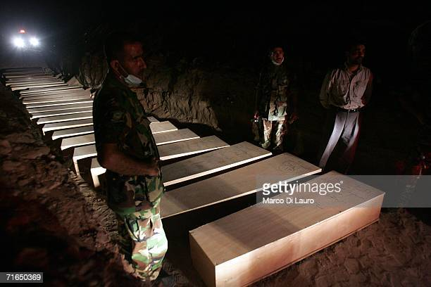 Lebanese Army soldier stands next to coffins containing victims of the conflict with Hezbollah and Israel August 15 2006 in Tyre southern Lebanon...