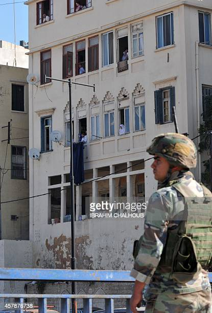 A Lebanese army soldier stands on a bridge over the Abu Ali river where the bodies of two young Sunni men were found on October 26 2014 next to the...