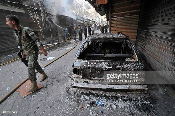 A Lebanese army soldier walks past a burnt car following clashes with Islamist gunmen in the historic market of the northern city of Tripoli on...