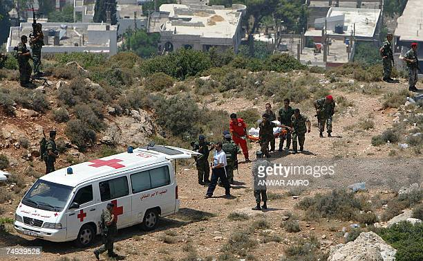 Lebanese army soldiers and Red Cross workers transfer a body of one of six Islamic militants who were killed in a clash with the army 28 June 2007 in...