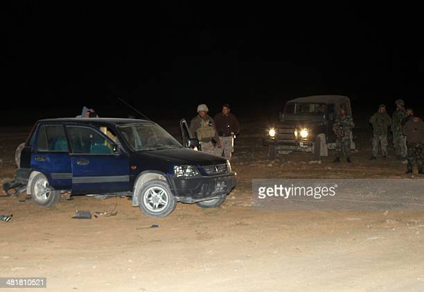 Lebanese army soldiers dismantle a vehicle packed with explosives early on April 1 close to an army checkpoint in Wadi Hmeid in the vicinity of Arsal...
