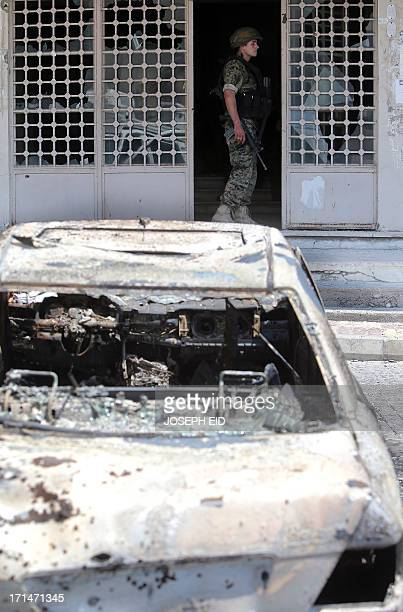 Lebanese army soldiers guard the entrance of a building near the Bilal bin Rabah mosque in the Abra district of the southern city of Sidon on June 25...