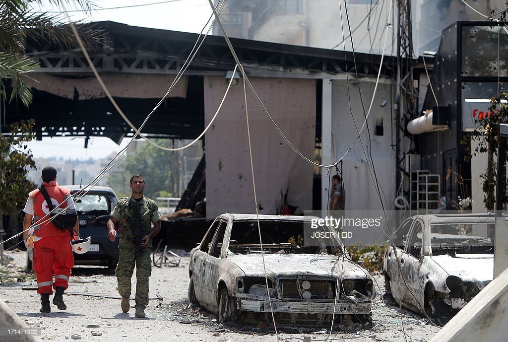 Lebanese army soldiers guard the entrance of the Bilal bin Rabah mosque in the Abra district of the southern city of Sidon on June 25, 2013, after troops seized control of the headquarters of a radical Sunni sheikh whose supporters battled the army for two days, killing 16 soldiers.