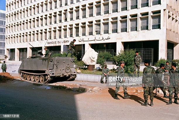 Lebanese army soldiers in an armoured personel carrier guard the Bank of Lebanon in a war torn downtown West Beirut street It was rumoured that this...