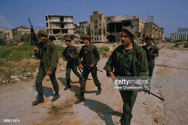 Lebanese Army soldiers on a patrol through bullet ridden buildings in wartorn streets close to the 'Green Line' the nomansland that divides the...