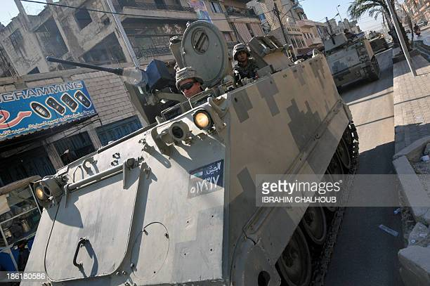 Lebanese army soldiers patrol a street in the northern Lebanese city of Tripoli on October 29 2013 as army deployed following a week of clashes...