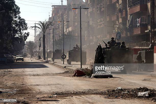 Lebanese army soldiers patrol Syria street in the northern Lebanese city of Tripoli on October 28 2013 as army began deploying following a week of...