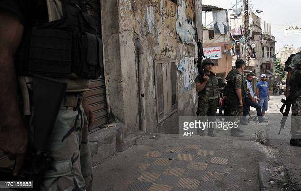 Lebanese army soldiers patrol the old city of the Lebanon's northern port of Tripoli on June 8 2013 to restore calm following clashes the previous...