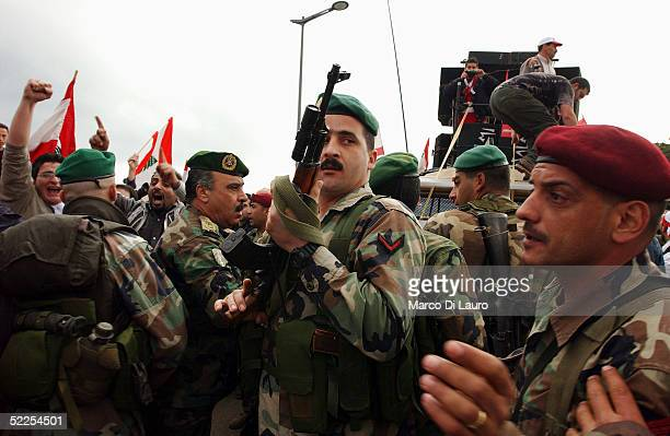 Lebanese Army Soldiers prevent the crowd participating in an antiSyrian demonstration on February 28 2005 in central Beirut Lebanon Despite a ban...