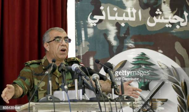 Lebanese army spokesman Ali Kanso gestures during a news conference at the Ministry of Defense in Yarze east of Beirut on August 19 about the Army's...