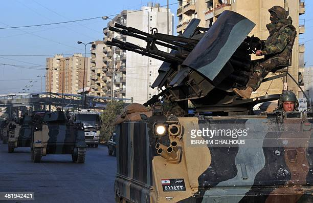 Lebanese army vehicles carrying Lebanese soldiers are deployed in the streets of the northern Lebanese city of Tripoli on April 2 2014 in the first...