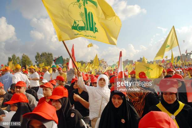 Lebanese attend a massive demonstration led by Hezbollah leader, Hassan Nasrullah, to celebrate what Hezbollah is calling 'The Divine Victory' in...