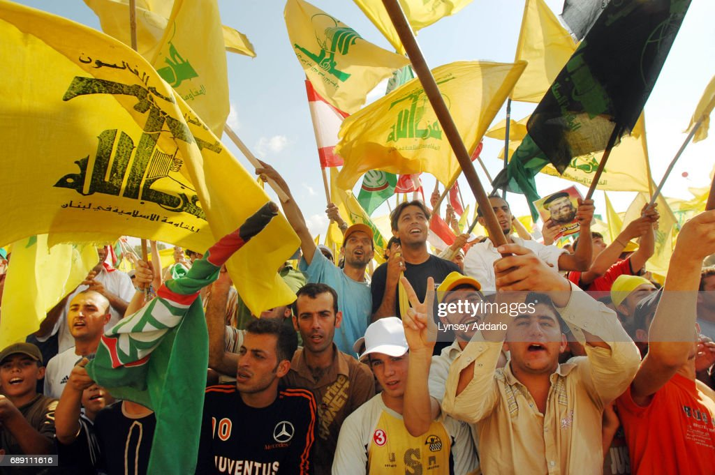 Lebanese attend a massive demonstration led by Hezbollah leader, Hassan Nasrullah, to celebrate what Hezbollah is calling 'The Divine Victory' in Beirut's southern suburbs, in Lebanon, September 22, 2006. Nasrullah made his first appearance since the beginning of Lebanon's war with Israel, and about one million Hezbollah supporters arrived from around the country to participate in the rally.