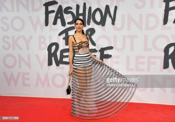 Lebanese Australian model and lawyer Jessica Kahawaty attends on May 13 2018 the Fashion For Relief Cannes 2018 event on the sidelines of the 71st...