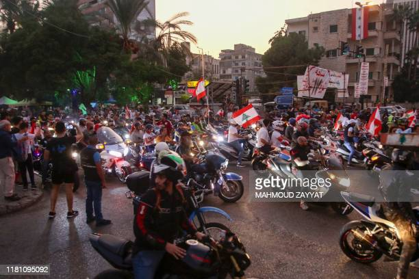 Lebanese bikers take part in an antigovernment demonstration in the southern city of Sidon on November 9 2019 A rationing of dollars by banks in...