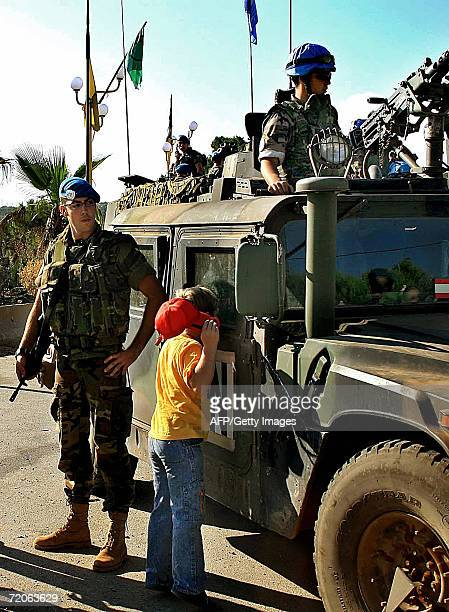Lebanese boy looks inside a Spanish UN military vehicle during their patrol in the Lebanese southern village of Kfar Kila at the border with Israel...