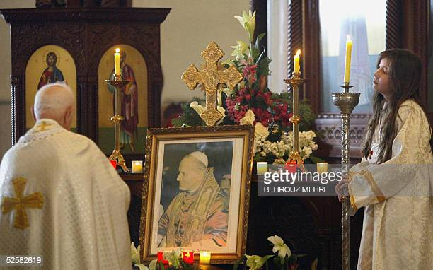 Lebanese catholic priest prays for John Paul II in a church in Harissa 03 April 2005 Bells tolled from Catholic churches in a Lebanon in mourning...