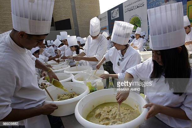 Lebanese chefs prepare the largest plate of hummus to set a new Guinness world record in Beirut on May 8 2010 The massive hummus serving weighed at...
