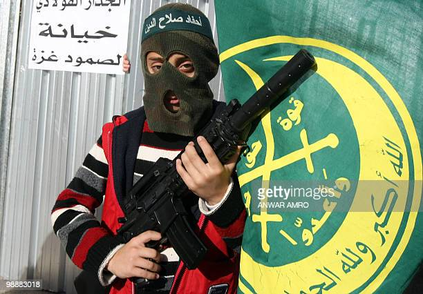 Lebanese child dressed as a militant attends a protest in front of the Egyptian embassy in Beirut on January 3, 2010 against a barrier Egypt is...