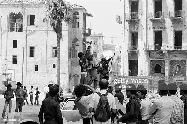 Lebanese children brandishing Kalashnikovs for the press, during the First Lebanon War.