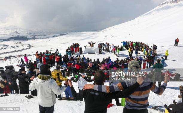 TOPSHOT Lebanese Christian Maronite father Hani Taouk leads a mass on the ski slopes of the Cedars mountains celebrating the Feast of Saint Maron on...