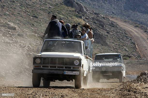 Lebanese Christian pilgrims arrive with trucks and offroad vehicles at a grouping area on August 5 2009 before climbing to the top of Mount Hermon814...