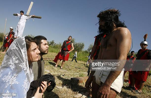 Lebanese Christians take part in a reenactment of the crucifixion of Jesus Christ during the Good Friday procession on April 3 2015 in the southern...