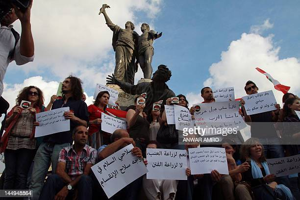 Lebanese citizens protest in downtown Beirut's Martyrs Square against sectarian violence on May 21 one day after street battles between pro and...