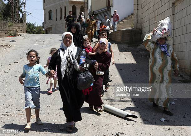 Lebanese civilians attempt to flee after being trapped in poor conditions as a result of the Israeli bombing campaign on August 1 2006 in the village...