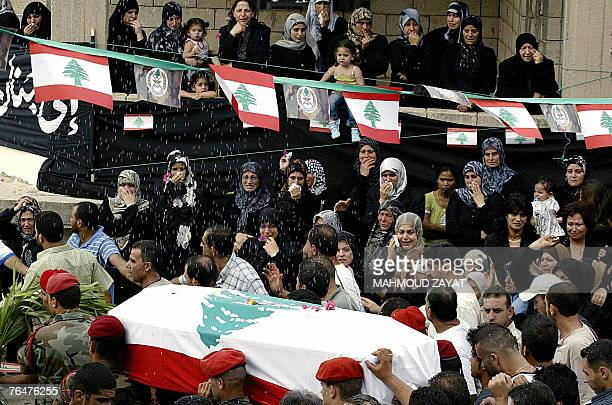 Lebanese civilians mourn during the funeral procession for Lebanese army officer Ali Nassar in the village of Kfar Hata south of Beirut 02 September...