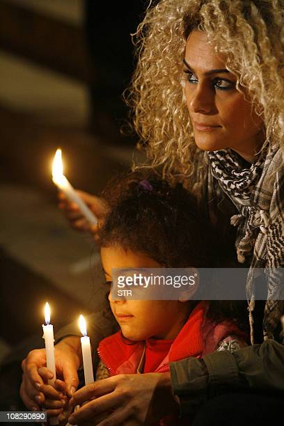 Lebanese civilians take part in a candle light vigil calling for peace in front of the National Museum in Beirut on January 24 2011 Outgoing Lebanese...