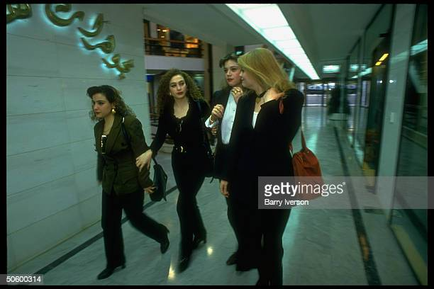 Lebanese college girl chums in sophisticated outfits on shopping jaunt, strolling hall in new, swanky upscale Verdun Plaza shopping mall.