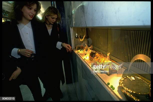 Lebanese college girl chums in sophisticated outfits poised at fine jewelry display window, shopping in new, swanky upscale Verdun Plaza shopping...