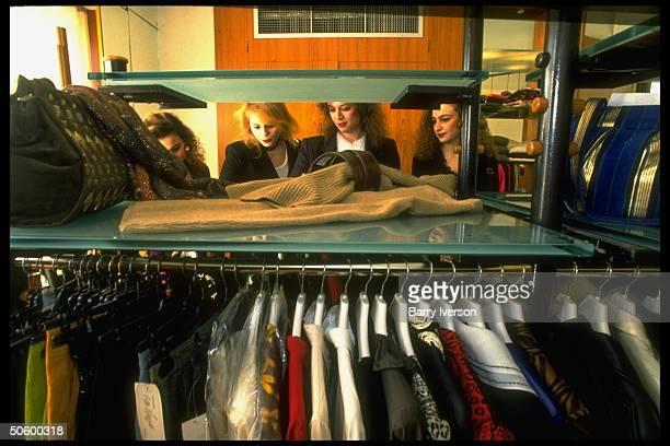 Lebanese college girls browsing through racks of clothing, shopping at new, swanky upscale Verdun Plaza shopping mall.