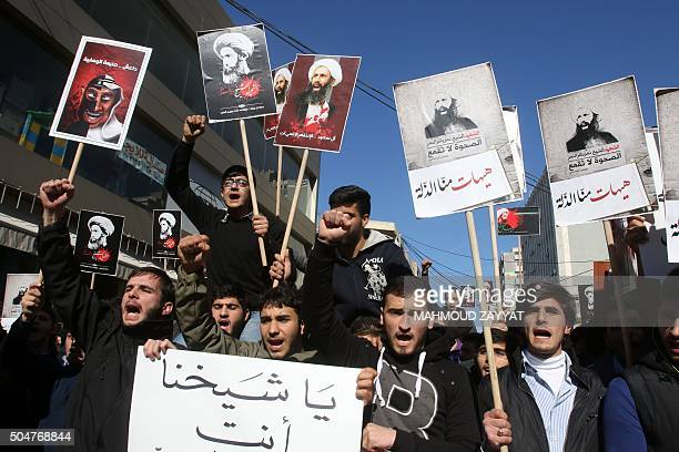 Lebanese college students raise placards during a demonstration on January 13 2016 in the southern Lebanese city of Nabatiyeh against the execution...