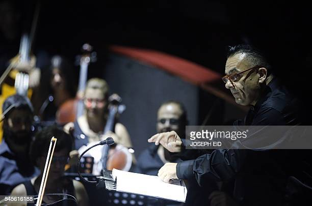 Lebanese composer and conductor Maroun Rahi leads the orchestra as they perform 'Antar and Abla' the first Lebanese opera in Arabic to be completed...