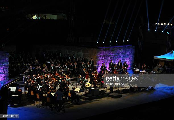 Lebanese composer Marcel Khalifeh plays the oud his performance at the 50th session of the International Carthage Festival on July 312014 at the...