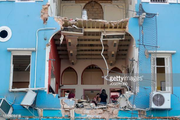 Lebanese couple inspect the damage to their house in Beirut's Gemmayzeh neighbourhood which overlooks the destroyed port of Lebanon's capital on...