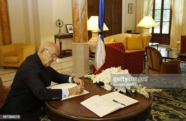 Lebanese Defence Minister Samir Moqbel signs a book of condolences at the Pine Residence, the French ambassadon's residence in the Lebanse capital...