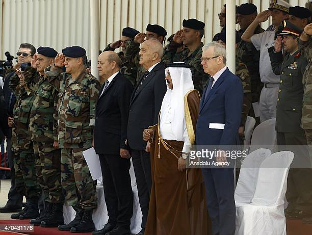 Lebanese Defense Minister Samir Mukbil and French Defense Minister JeanYves Le Drian attend a ceremony as the Lebanese army receive the first...