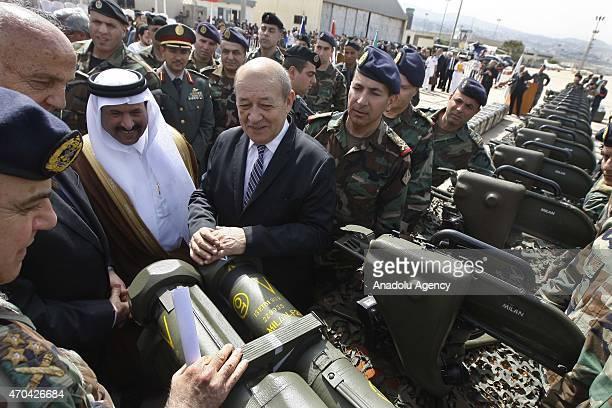 Lebanese Defense Minister Samir Mukbil French Defense Minister JeanYves Le Drian and Lebanese army commander Gen Jean Kahwaji attend a ceremony as...