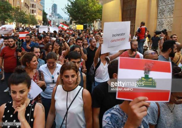 Lebanese demonstrate in central Beirut to denounce a plan by authorities to install waste incinerators in the country and corruption on August 29...