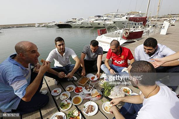 Lebanese demonstraters picnic at Beirut's Zaitunay Bay during a protest as a part of the 'Change is Coming' campaign against the privatisation of...