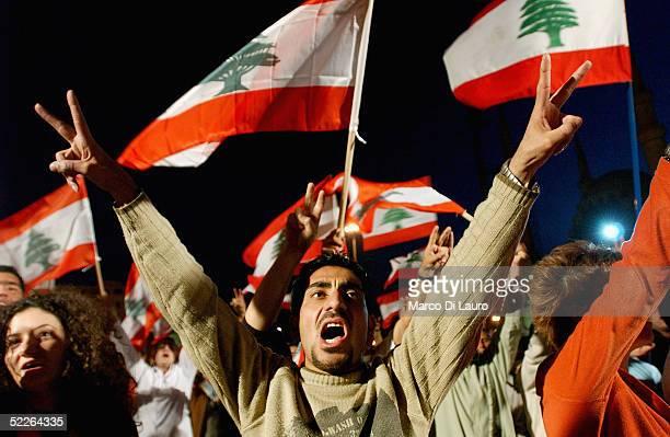 Lebanese demonstrator flashes the victory sign in Martyr Square during an anti-Syrian demonstration on March 2, 2005 in Beirut, Lebanon. A few...