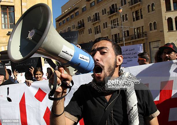 Lebanese demonstrator shouts slogans during a protest organised by civil society groups near the parliament building, where lawmakers are meeting for...