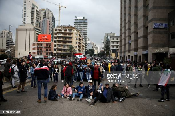 Lebanese demonstrators block the main bridge linking the western and eastern sides of the capital Beirut, to protest against a political elite...