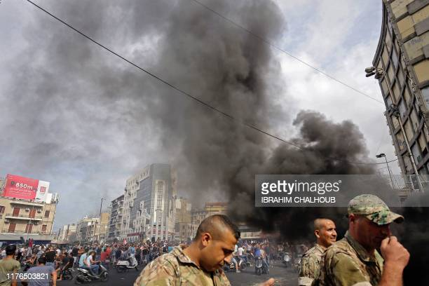 Lebanese demonstrators burn tires during a protest against dire economic conditions on October 18 2019 in the northern port city of Tripoli Public...