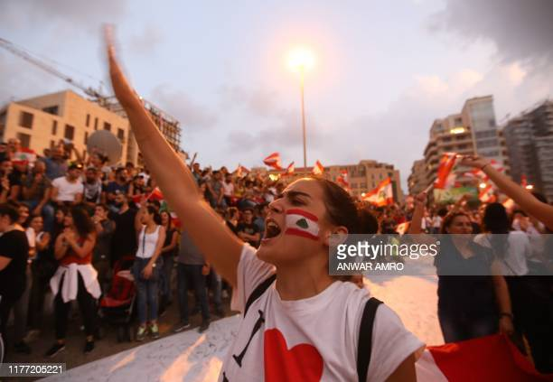 TOPSHOT Lebanese demonstrators chant slogans as they take part in a rally in the capital Beirut's downtown district on October 20 2019 Thousands...