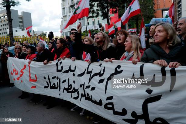 Lebanese demonstrators chant slogans during a demonstration outside the Electricite du Liban national company headquarters in the Lebanese capital...