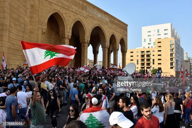 Lebanese demonstrators gather at Martyrs' Square and Riad Al Solh Square during an antigovernment protest against dire economic conditions and new...